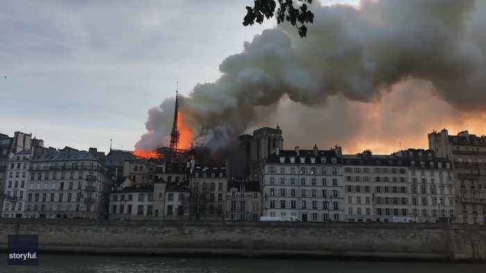 Spire Falls as Flames Engulf Notre Dame Cathedral in Paris