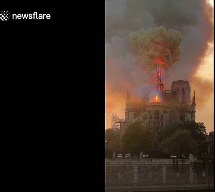 Shocking moment iconic Notre-Dame spire collapses into flames