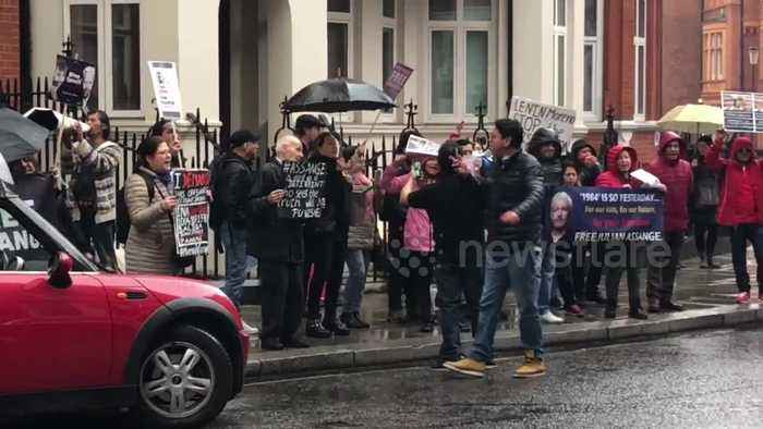 Small crowd of Assange supporters protest outside Ecuador Embassy in London