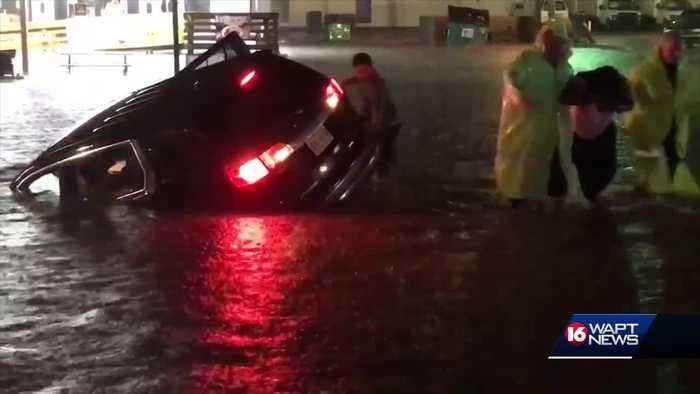 Woman and daughter rescued from flood waters