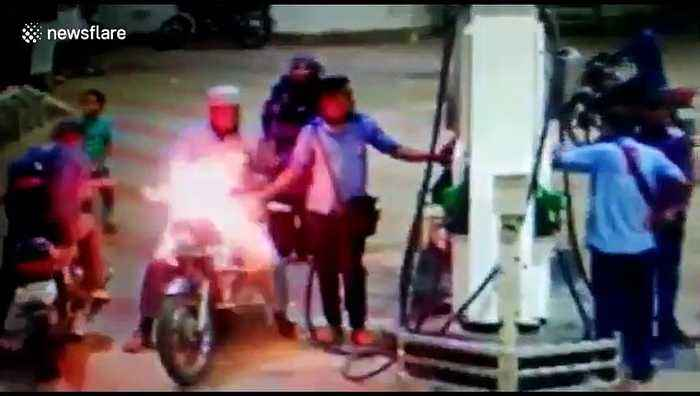 Horrifying moment motorbike catches fire at petrol pump in west India