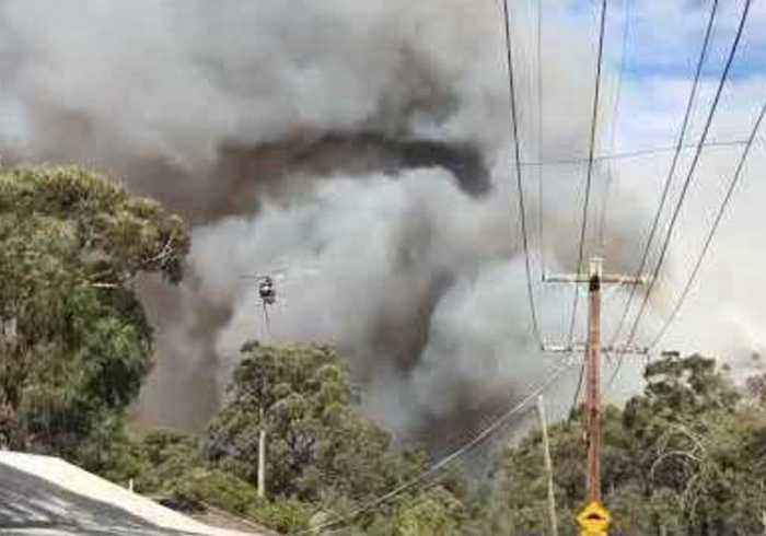 Helicopter Flies Over Mount Clear Bushfire