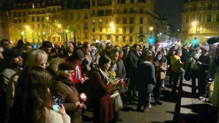 Parisians Gather to Sing Hymns at Notre Dame Cathedral After Fire