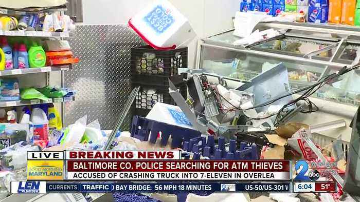 Baltimore County Police search for the suspects who stole an ATM at a 7-Eleven in Overlea