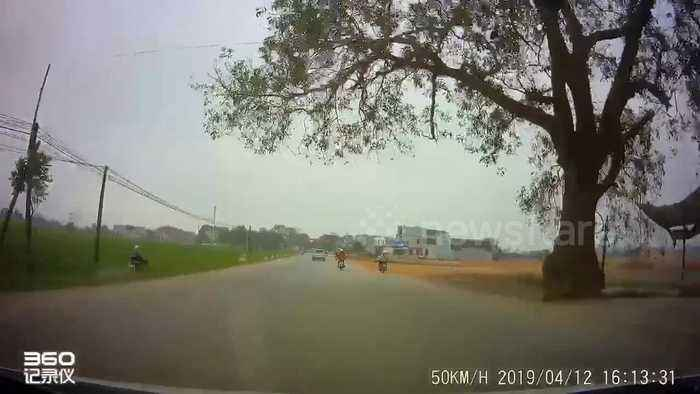 Asleep at the wheel! Funny scene as motorcyclist dozes off and falls into rice paddy ditch