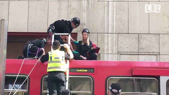 Moment Climate Change Protesters Removed From DLR Train By Police