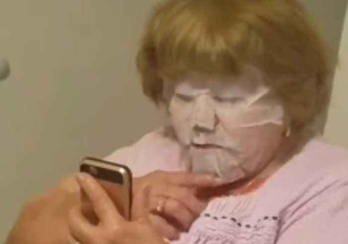 Grandma Checks Herself Out While Wearing Sheet Mask for the First Time