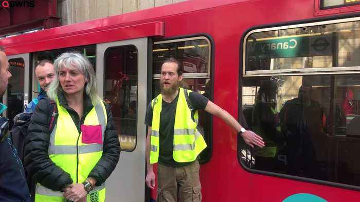 Environment protesters stand on top of LDN train