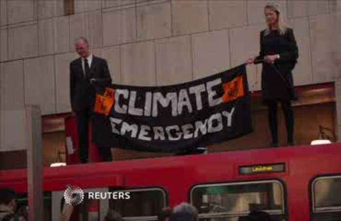 Climate change protesters glue themselves to London train
