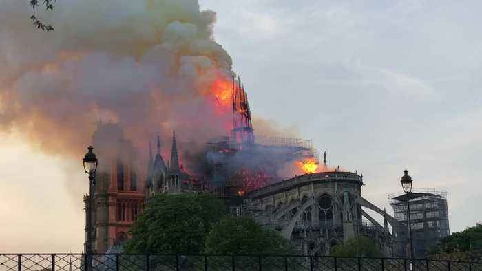 Notre Dame Spire Falling