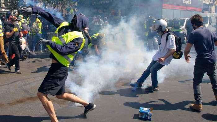 Paris Police Break Out Tear Gas To Thwart 'Yellow Vest' Demonstrators