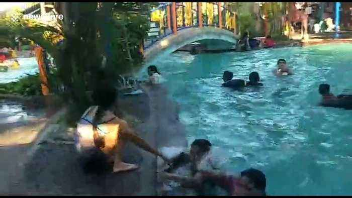 Philippines earthquake hits children's swimming pool causing waves