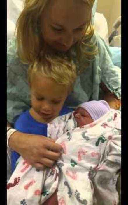 Little Boy Meets Newborn Brother for the First Time