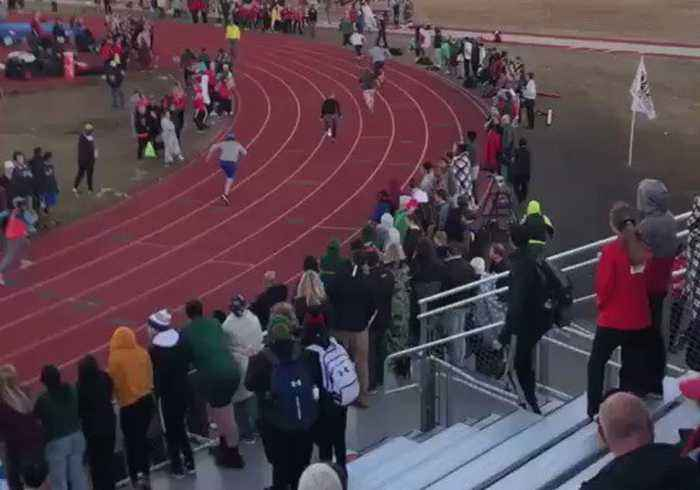 Crowd Cheers as Coaches Race Each Other at High School Track Meet