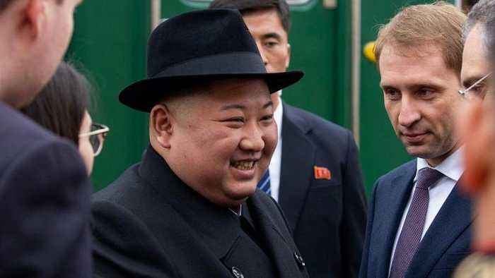 Kim Jong Un greeted with bread and flowers as he arrives in Russia for Putin meeting