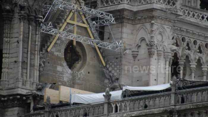 Notre-Dame covered in tarpaulin to protect it from expected rain