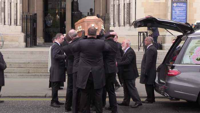 Mourners break into applause as Lyra McKee's coffin is carried into church