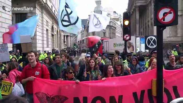 Extinction Rebellion activists block road in central London on the final day of protests