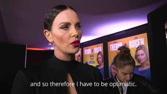 Charlize Theron staying positive about US politics for the sake of her children