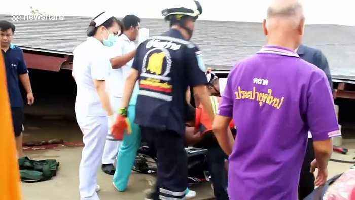 Motorcyclist survives building collapse during tropical storms in Thailand