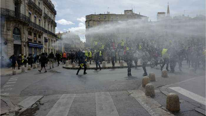French Police Hit With Tear Gas To Prevent Them From Reaching Parliament Building