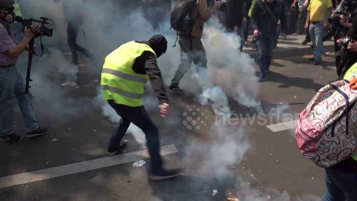 Riot police clash with yellow vest and anti-capitalist 'black bloc' protestors during May Day demonstrations in Paris