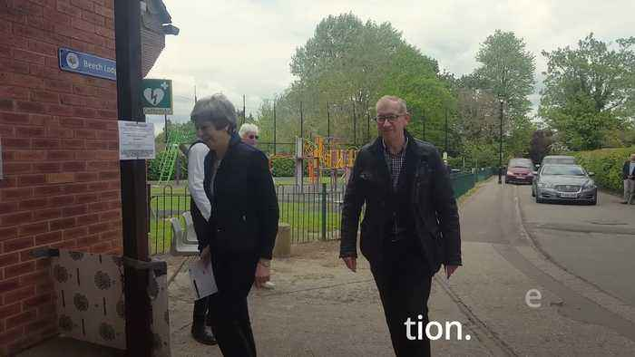 Theresa May casts vote in local elections