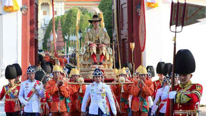 Thailand's New King Carried Through Street By 16 Men