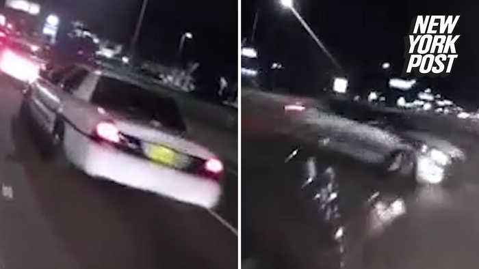 Dumb motorcyclist taunts cops and then crashes