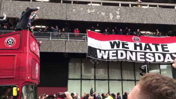 Sheffield United fans celebrate promotion with open-top bus tour chanting 'We hate Wednesday!'