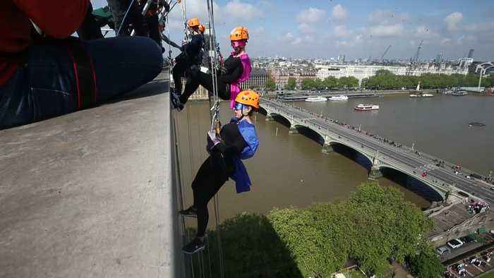 Fundraisers abseil off hospital roof in central London