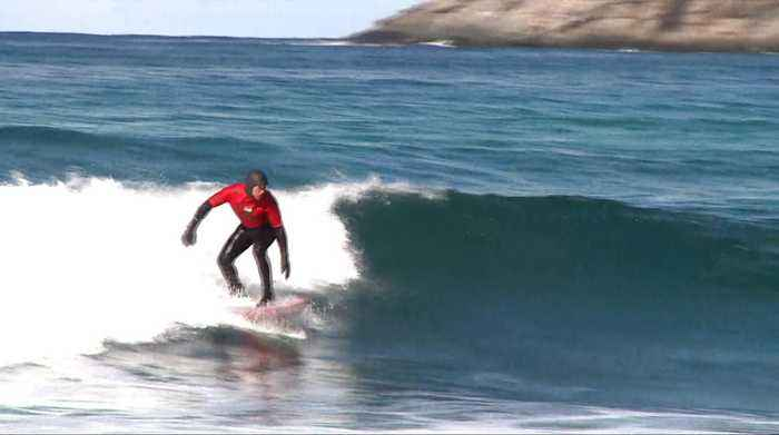 Arctic surfing: Snow, sand and the northern lights