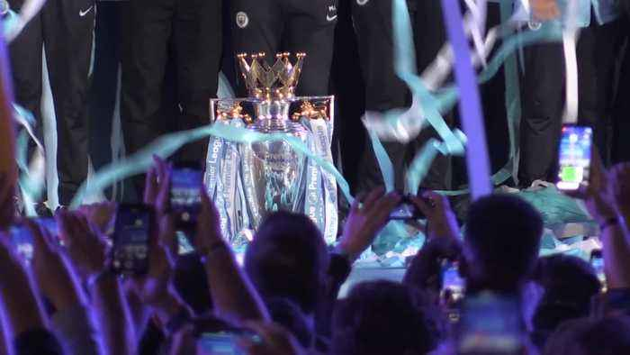 Guardiola and players celebrate title win with fans at Etihad