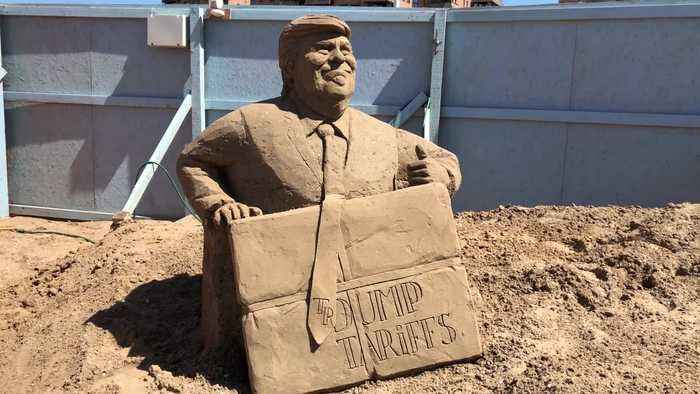 Theresa May and Donald Trump star in annual sand art display