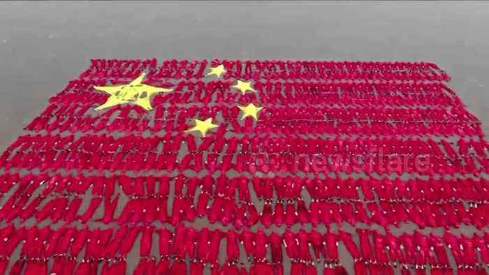 Hundreds of swimmers form Chinese national flag in Salt Lake to set Guinness World Record