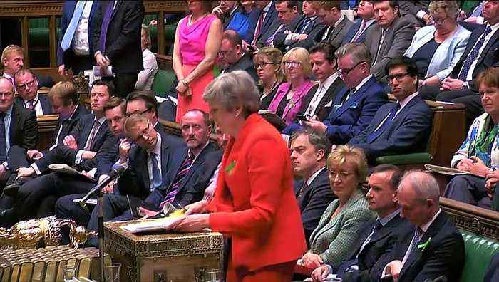 May says she is 'committed to delivering Brexit'