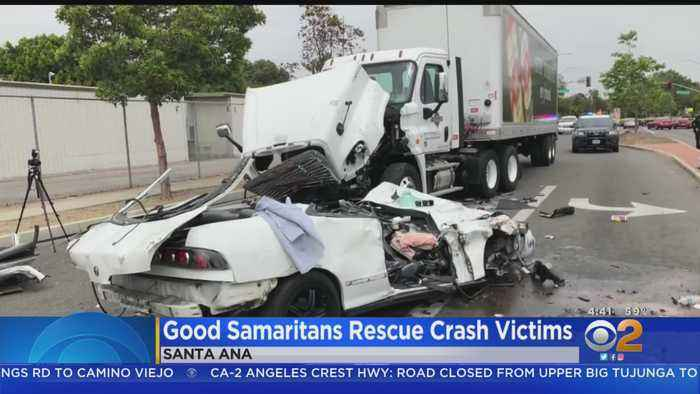 Strangers Rush To Help Men Trapped After Head-On Crash With Big Rig