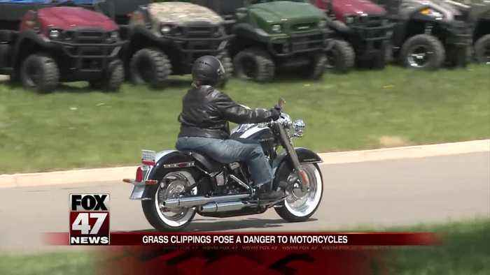 Bikers warn people of grass clippings