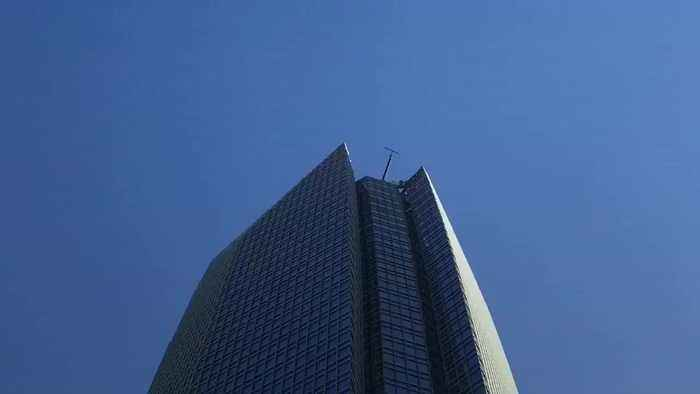 Window cleaning platform swings out of control at top of skyscraper