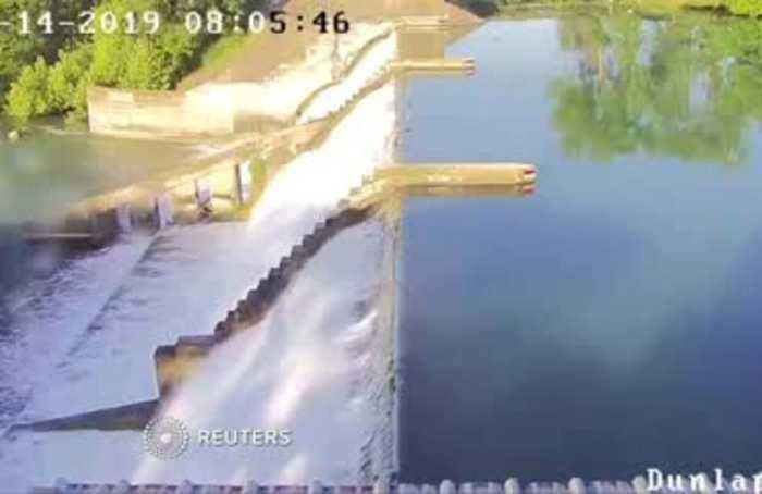 Texas partial dam collapse captured on video