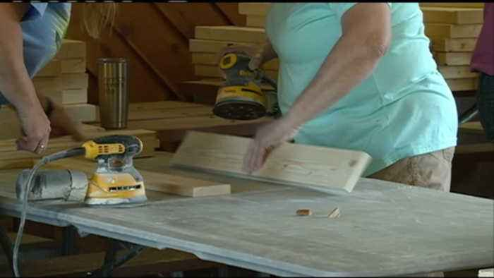 Volunteers build 20 beds for children in the Tri-County area