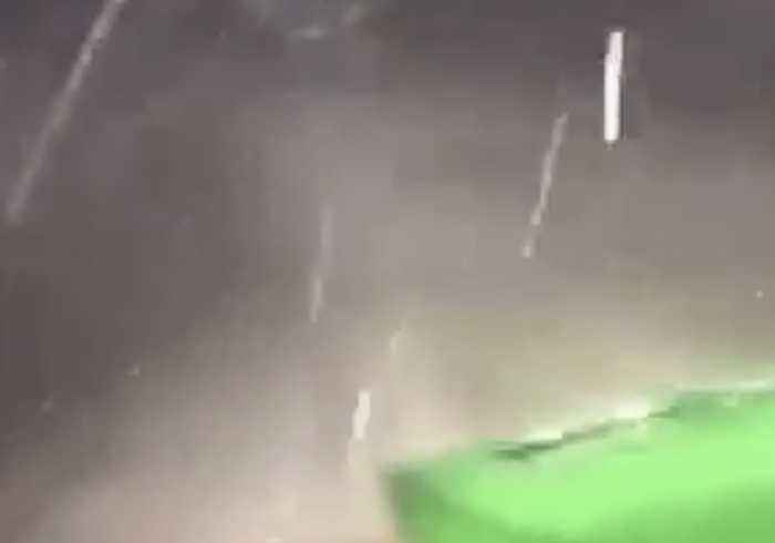 Hailstones Pelt Tractor as Storms Roll Through North Dakota