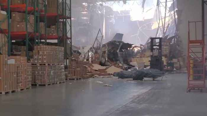 Fighter Jet Just Crashes Through Warehouse Wall