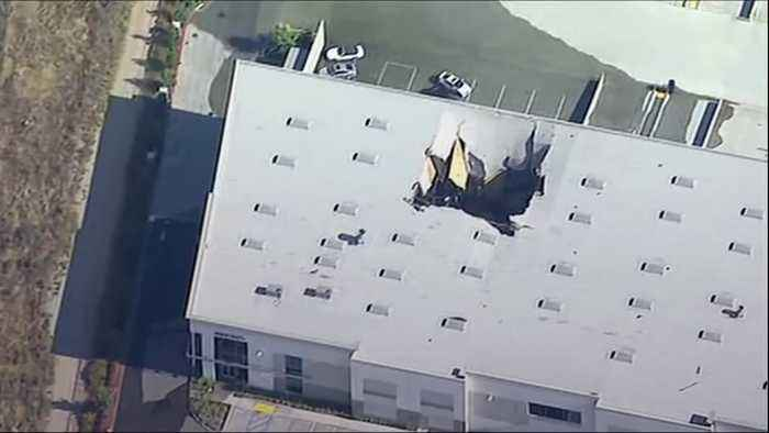 F-16 fighter jet crashes into warehouse near Los Angeles