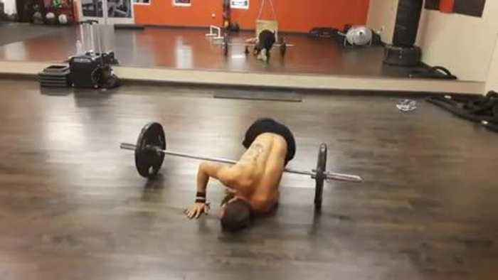 Man Faceplants Attempting to Do Rolling Handstand on Top of Barbell Weight
