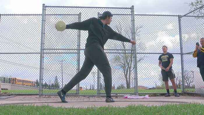 Top Thrower Competes Against State-- And Family