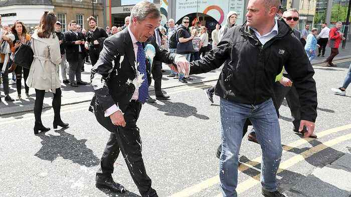 Nigel Farage doused in milkshake on the campaign trail