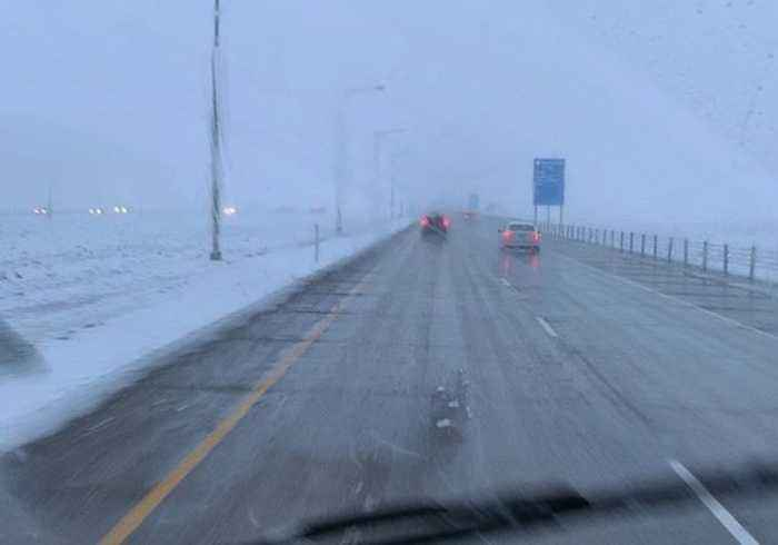 May Snowfall Causes Low Visibility on Denver Roads