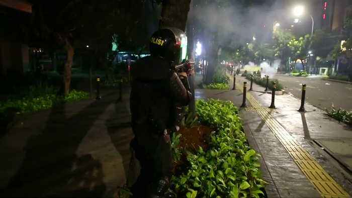 Indonesian police fire teargas on protestors