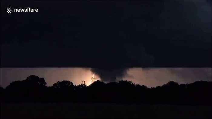 Terrifying night-tornado illuminated by streaks of lightning in Oklahoma, USA